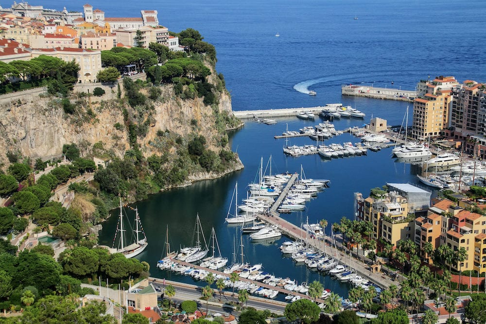 View of Monaco City with boat marina below in Monaco. Monaco City is one of the four traditional quarters of Monaco.