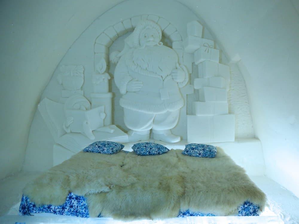 KEMI, FINLAND - Unique beautifully decorated Santa Claus snow suite in Snow Hotel at LumiLinna Snow Castle in Kemi, Finland. Snow Hotel is the World Luxury Hotel Global Award Winner