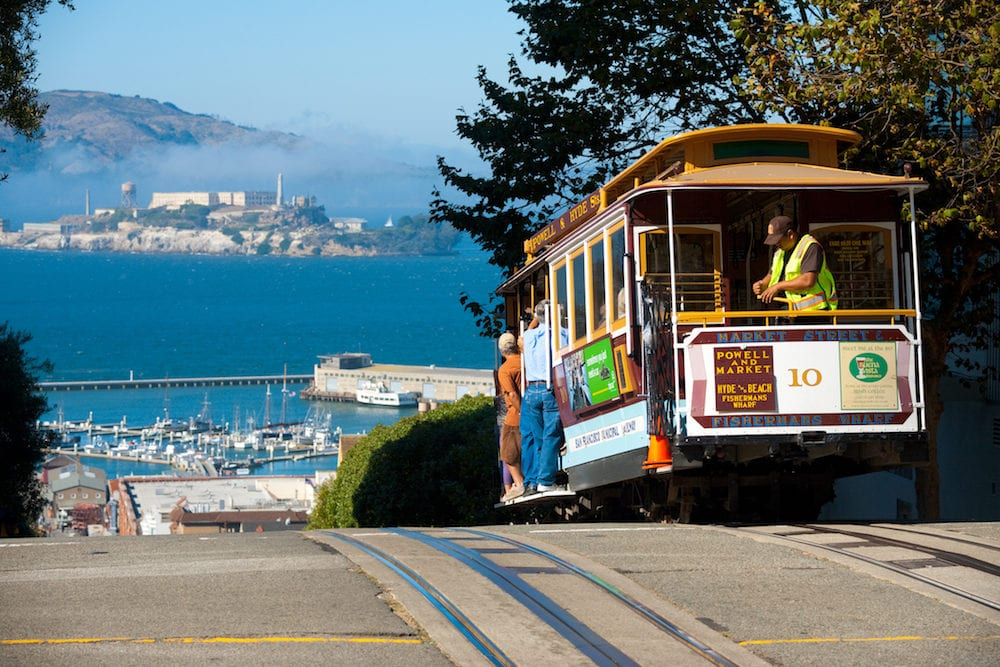San Francisco USA - : A cable car an iconic mode of San Francisco transportation meets an iconic landmark Alcatraz Prison at the top of Hyde Street at San Francisco California USA
