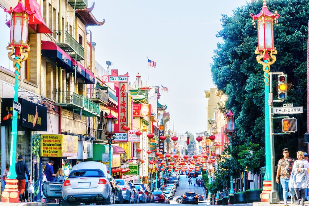 SAN FRANCISCO -: Red lanterns hang along busy Grant Avenue in the heart of San Francisco Chinatown. Teeming with Chinese restaurants and shops, it is one of the oldest and largest Chinatowns in North America.