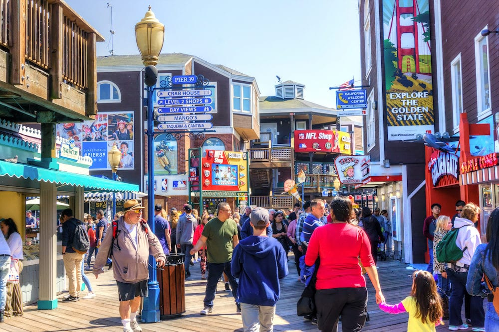 SAN FRANCISCO - : Visitors flock to Pier 39 at San Francisco Fishermans Wharf renowned for its varied attractions, shops and seafood.
