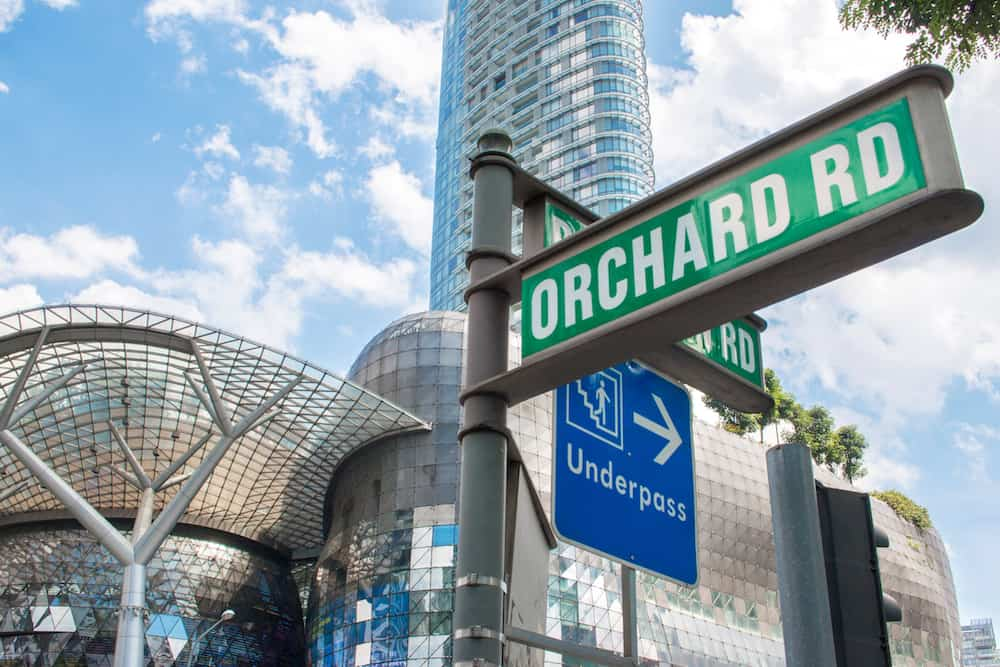 SINGAPORE - : Street sign or traffic sign of Orchard Road with underpass sign for tourist. The famous shopping main street Orchard Road area in Singapore.