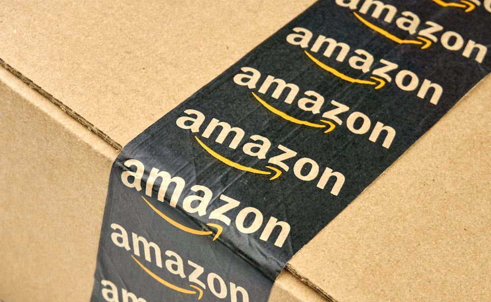 MONTREAL CANADA - - Amazon shipping box with branded tape on it. Amazon is one of the most popular and biggest online store.