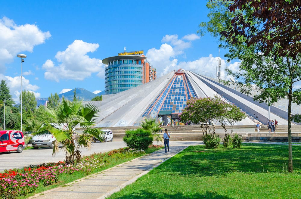 "TIRANA ALBANA - Unknown people are near building ""Pyramid"" (former museum of communist dictator Enver Hoxha) Tirana Albania"