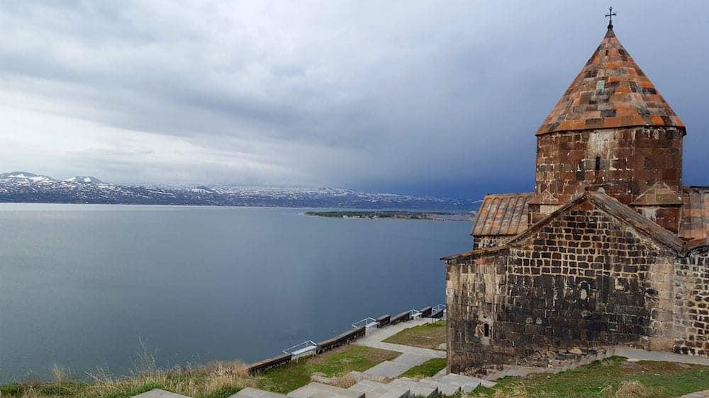 Sevan, Armenia - The ancient Sevanavank monastery, lake Sevan in the background Sevan, Armenia