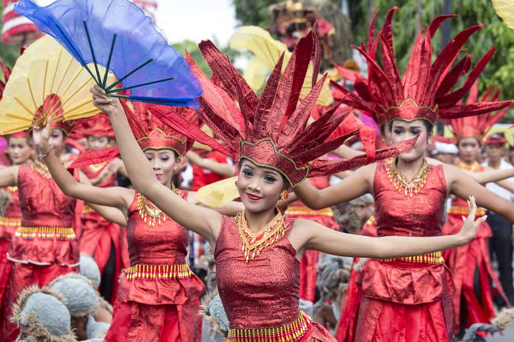 GIANYAR, BALI, INDONESIA -:Unknown Balinese girls dressed in national costume, participates in street ceremony during a pre-election rally the Indonesian Democratic Party of Struggle