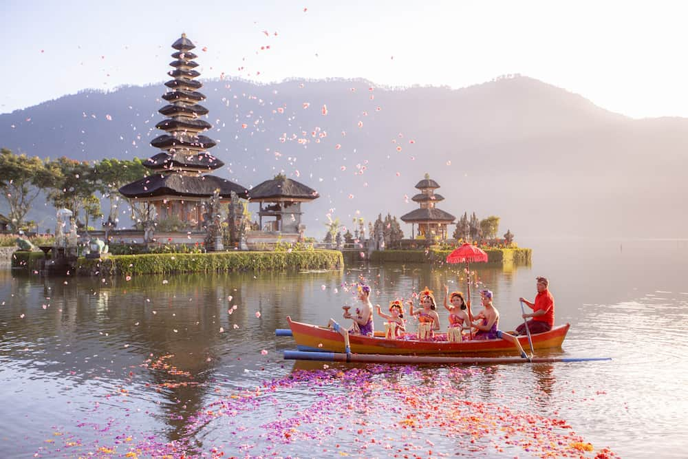 Beratan Lake in Bali Indonesia,: Balinese villagers participating in traditional religious Hindu procession in Ulun Danu temple Beratan Lake in Bali Indonesia