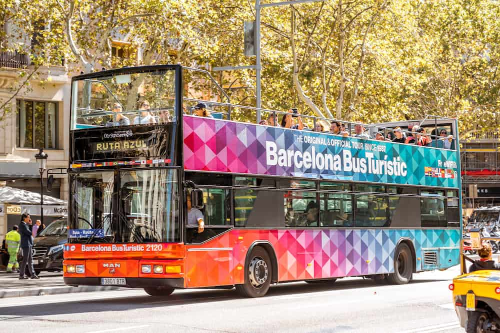 BARCELONA, SPAIN - : Barcelona city tour bus with people on the street in Barcelona city