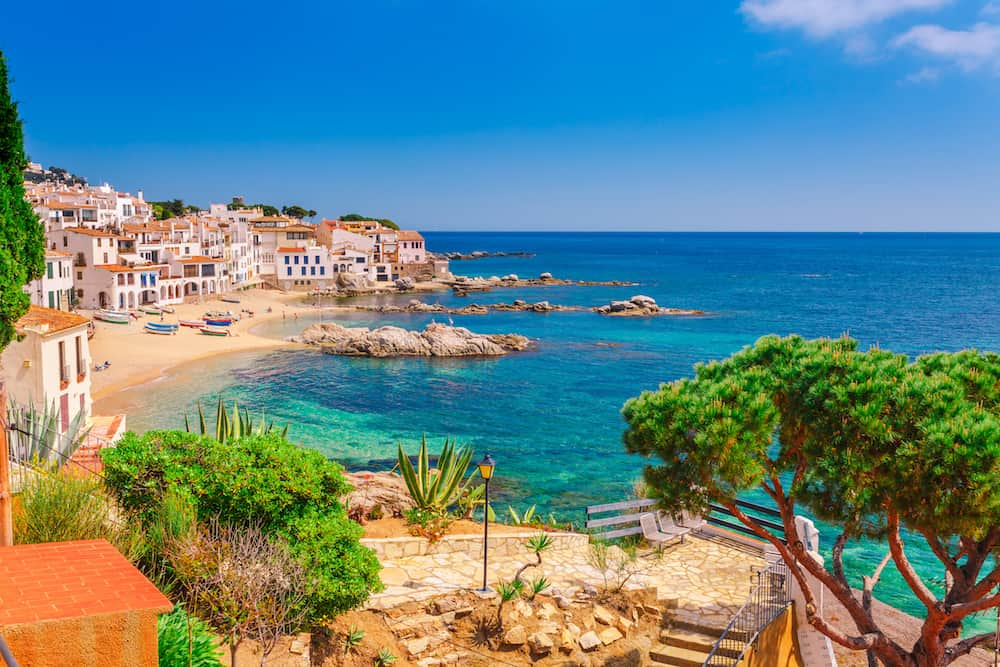 Sea landscape with Calella de Palafrugell Catalonia Spain near of Barcelona. Scenic fisherman village with nice sand beach and clear blue water in nice bay. Famous tourist destination in Costa Brava