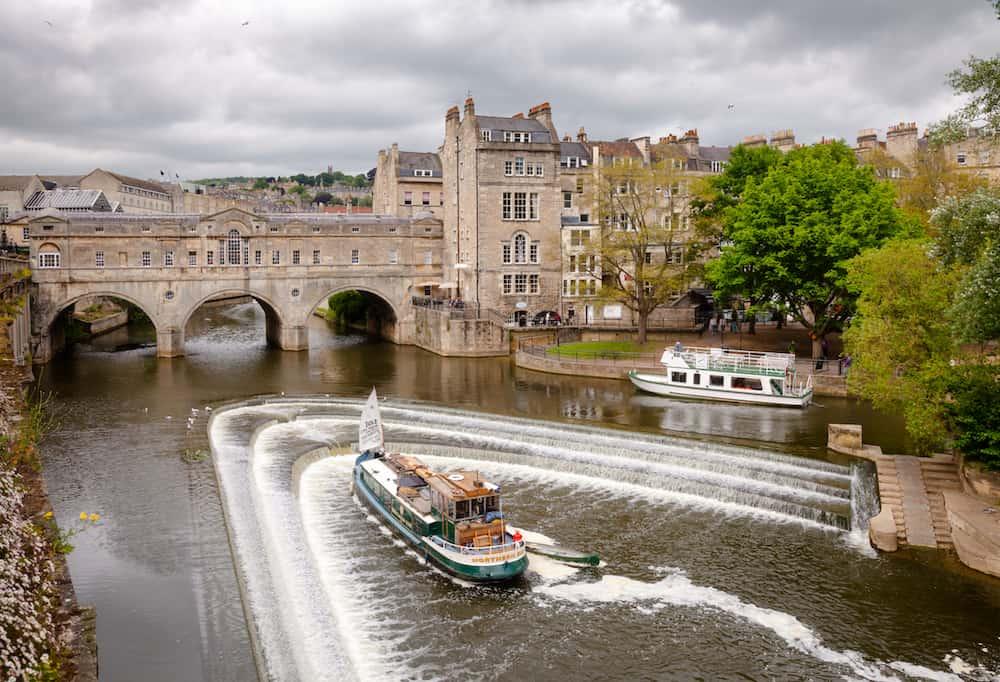 BATH, UK - : City scene with weir on the River Avon near Palladian Pulteney Bridge