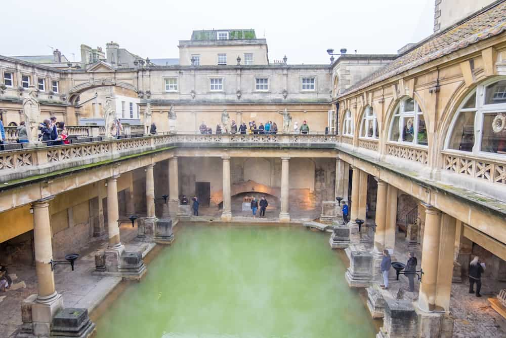 Bath UK - View of inside Historic Roman Baths with Bath Abbey in the Historic Somerset Bath city United Kingdom.