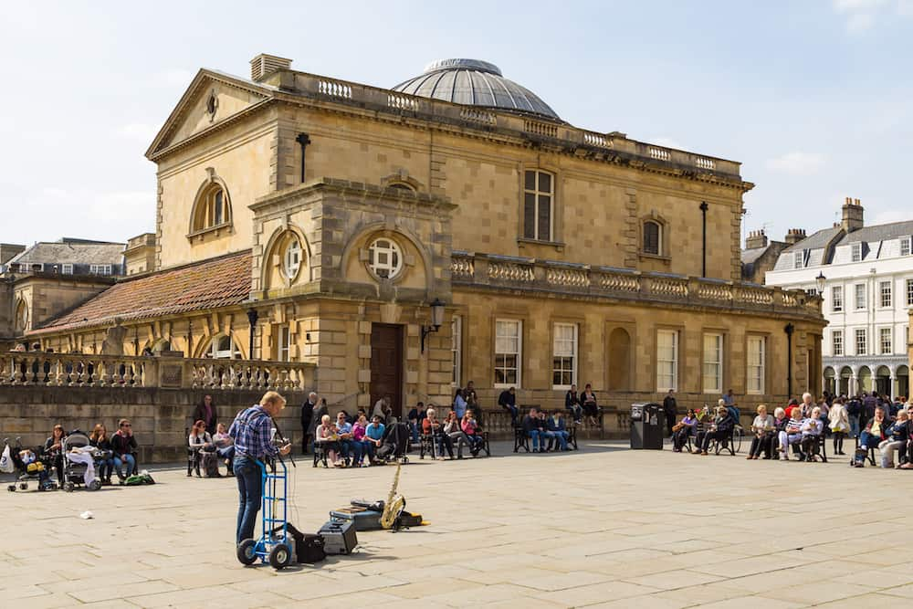 Bath, England, UK- Street view of old, historic town Bath. Bath is known for the curative Roman-built baths.