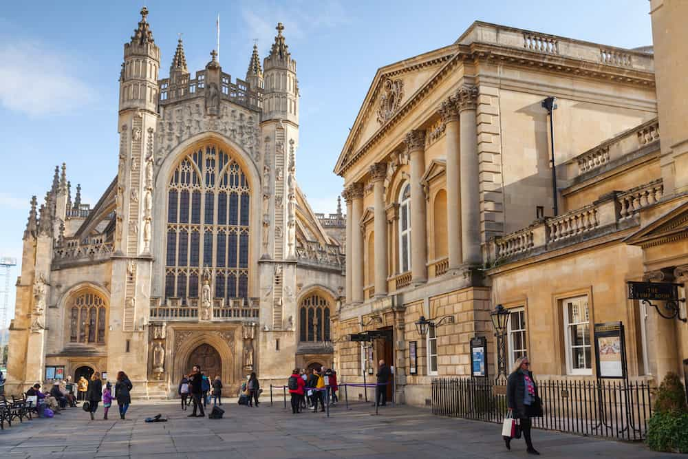 Bath United Kingdom - Street view with The Abbey Church of Saint Peter and Saint Paul Bath commonly known as Bath Abbey. Ordinary people walk on city square