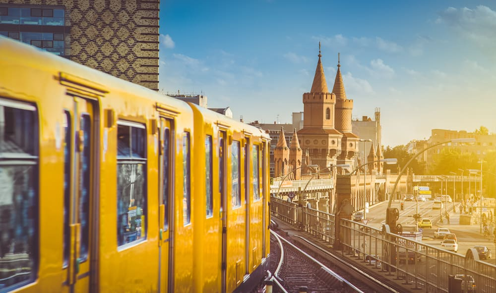 Berliner U-Bahn with famous Oberbaum Bridge in the background in beautiful golden evening light at sunset Berlin Friedrichshain-Kreuzberg Germany