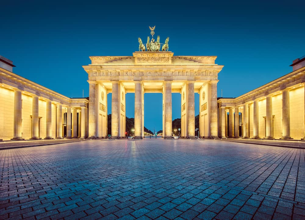 Classic view of famous Brandenburger Tor (Brandenburg Gate) one of the best-known landmarks and national symbols of Germany in twilight during blue hour at dawn Berlin Germany