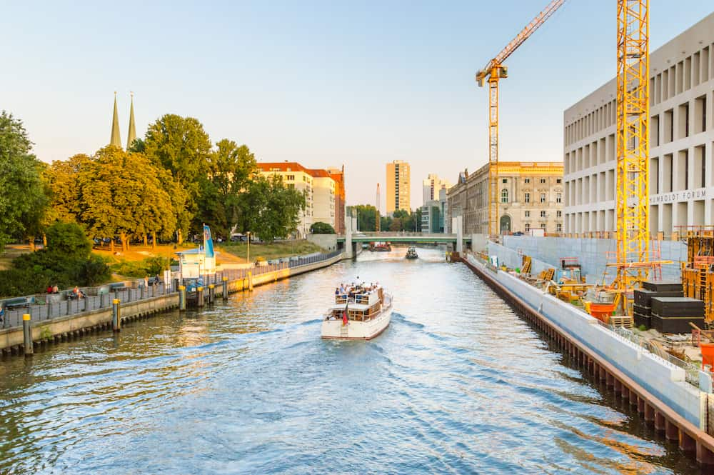 Berlin, Germany - Crew boats on Spree river at sunset.
