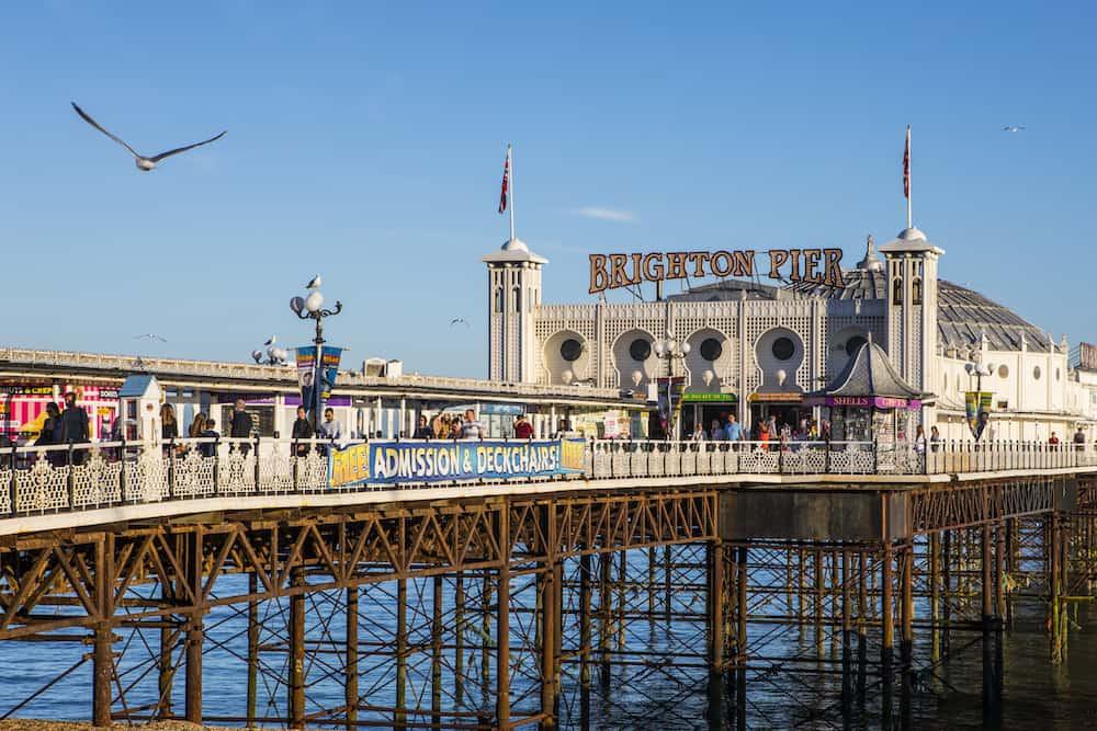 BRIGHTON UK - : A view of the historic Brighton Pier in Brighton UK