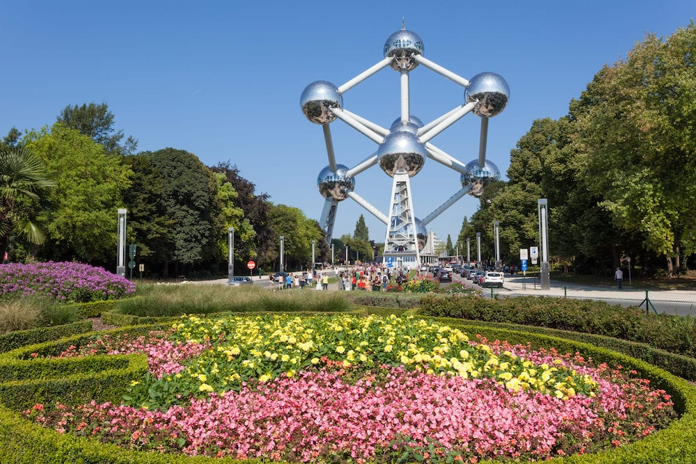 BRUSSELS BELGIUM - Flower bed and the Atomium building at the World Fair grounds in Brussels.