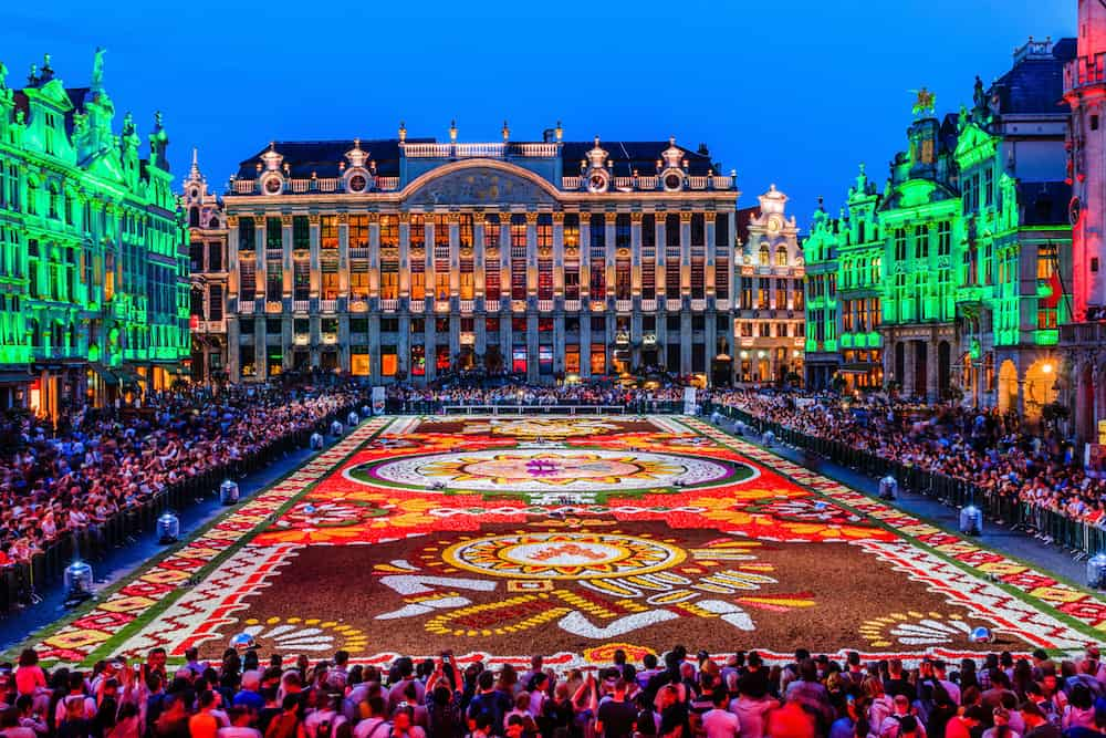 Brussels, Belgium - Grand Place at night during Flower Carpet Festival.
