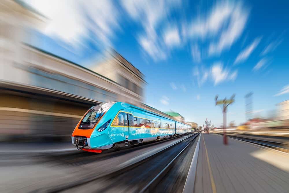 High-speed train with motion blur. Train at the railway station. Train station. Train at the station.