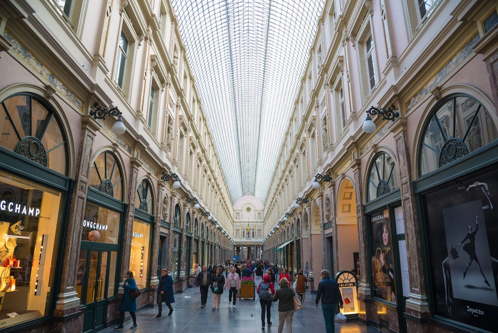 Brussels, Belgium - People shop in the historical Galeries Royales Saint-Hubert shopping arcades in Brussels