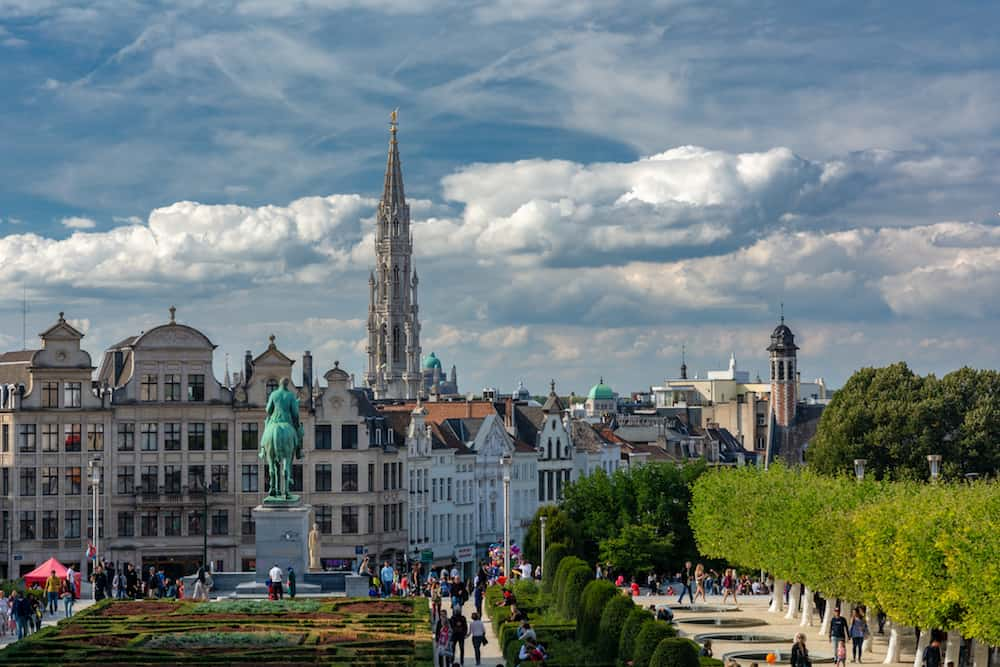 Brussels, Belgium - Tourists in scene of Brussels city from Mont des Arts (Mount of the arts) with Town Hall on Grand Place and Equestrian monument of King Albert I