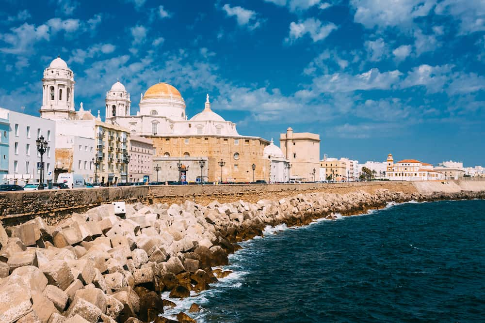 Cadiz, Spain -: Ancient Cadiz city in southern Spain. Cadiz Cathedral and old town.
