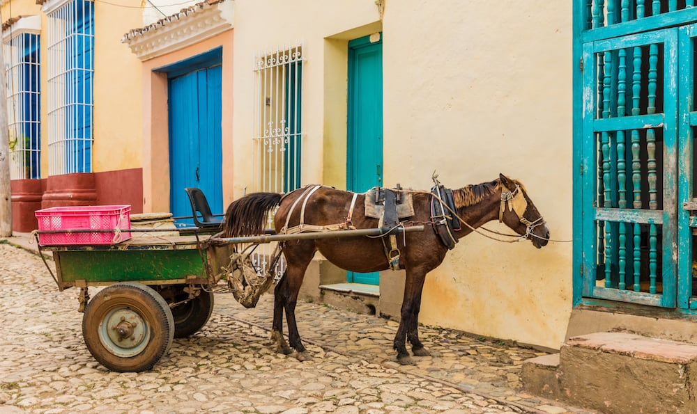 Trinidad, cuba. A view of a horse and cart in a colourful street in Trinidad in Cuba