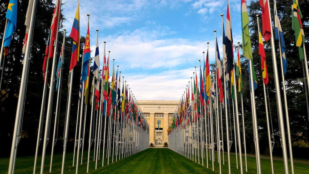 GENEVA, SWITZERLAND - : National flags at the entrance in UN office at Geneva, Switzerland . The United Nations was established in Geneva in 1947 and is the second largest UN office.