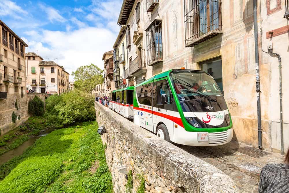 Granada, Andalucia, Spain Granada City Tour with the shuttle along the Carrera del Darro in the popular old Moorish Albaicin quarter. It's located on a hill facing the Alhambra.