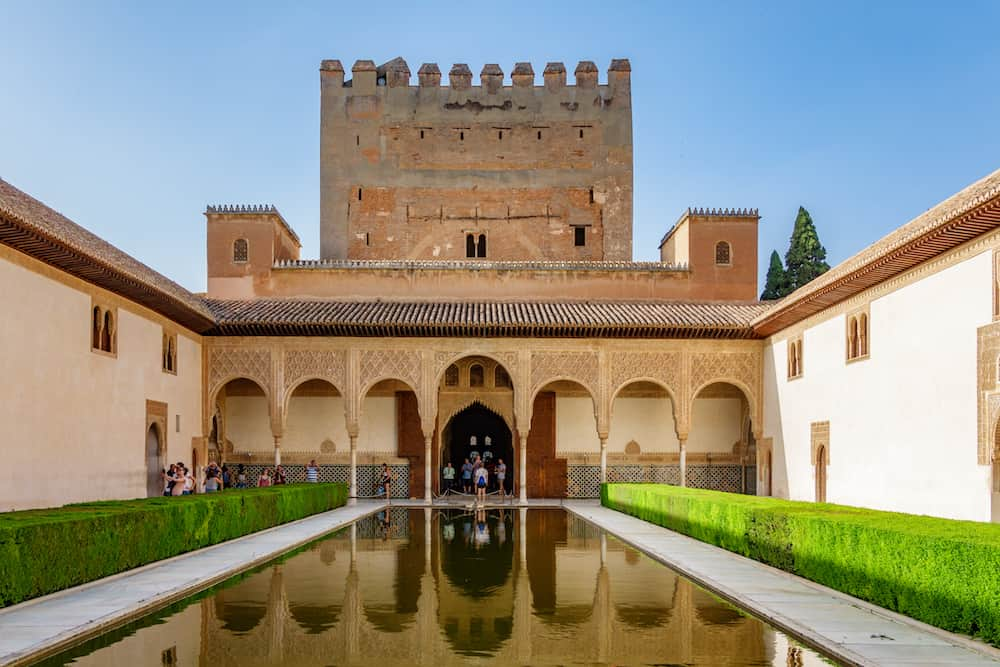 Granada, Spain - General view of The Generalife courtyard with its famous fountain and garden inside the Alhambra in Granada, Spain