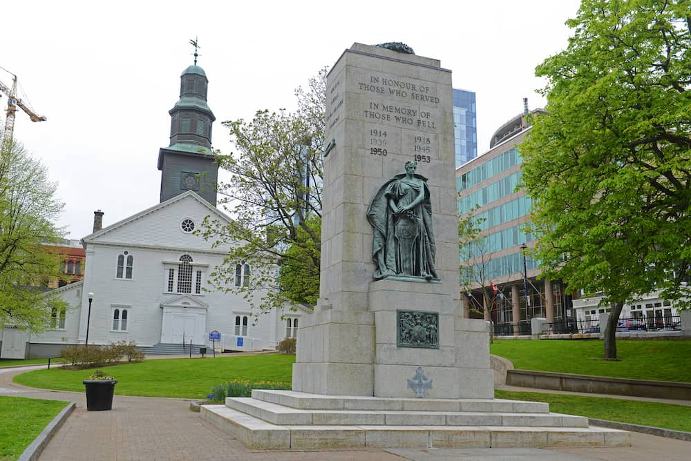 HALIFAX, NS, CANADA - Cenotaph and St Paul`s Anglican Church on Grand Parade Square in downtown Halifax, Nova Scotia, Canada.