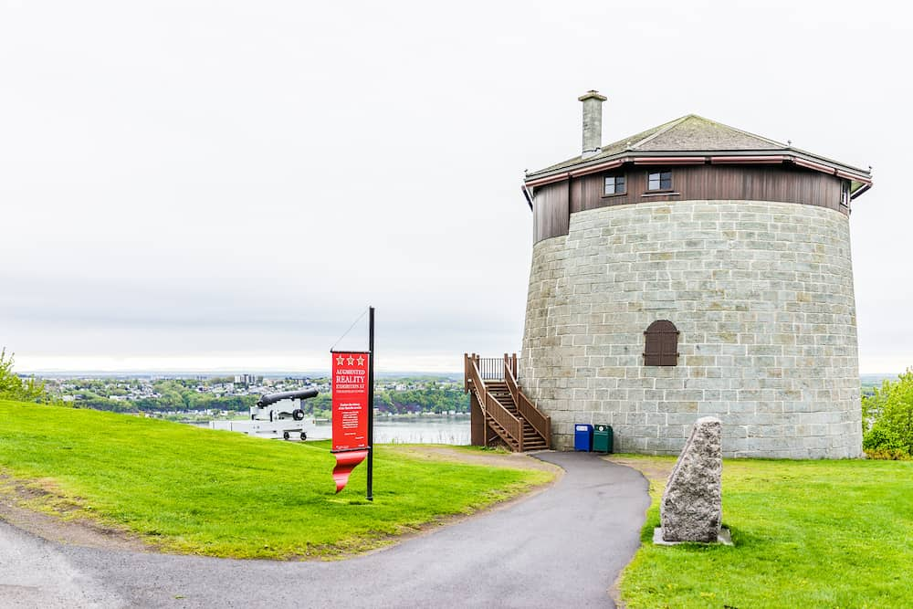 Quebec City Canada - Martello tower watchtower in plaines d'Abraham with sign and cannon overlooking the Saint Lawrence river