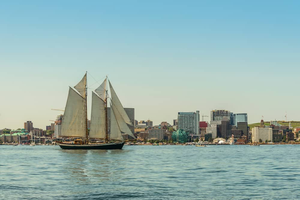 Tall ship in the harbour with Halifax downtown skyline on a sunny day (During the Nova Scotia Tall Ship Festival 2017)