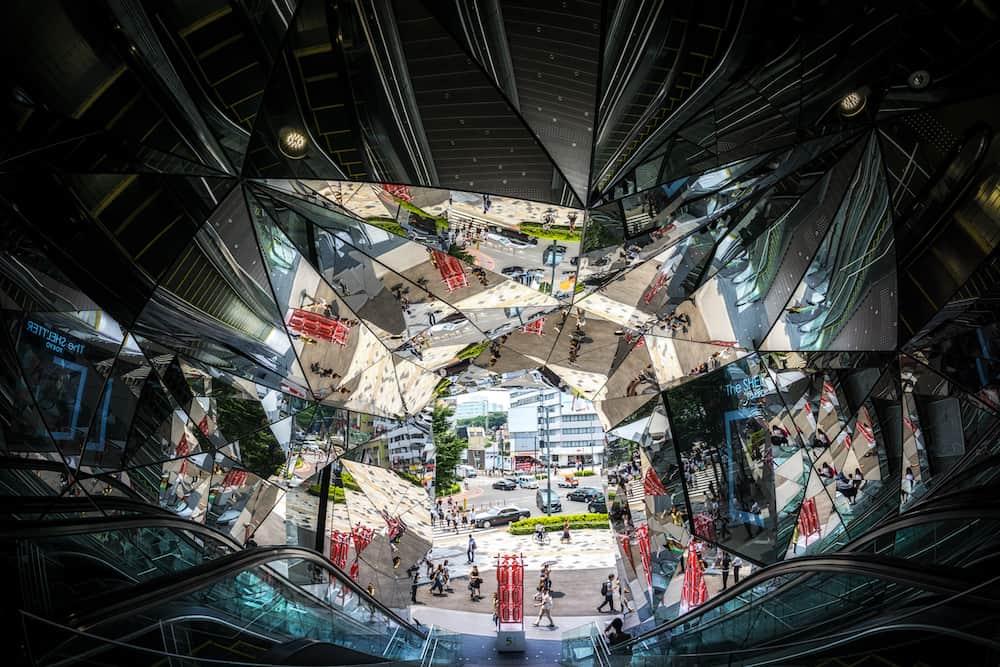 tokyu plaza omotesando shopping mall in harajuku tokyo kaleidoscopic entrance with escalators on the side