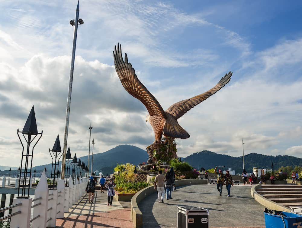 Langkawi, Malaysia -. Eagle Square on Langkawi Island, in late afternoon light. This giant Eagle statue is the symbol of Langkawi, Malaysia.