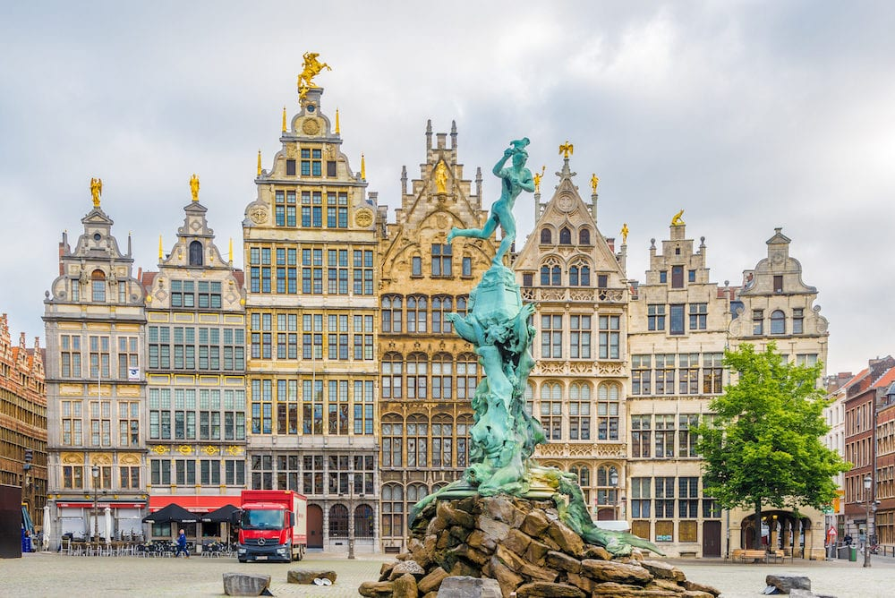 ANTWERP,BELGIUM - Brabo monument with Gildhouses at the Grote markt in Antwerp. Antwerp is a city in Belgium, and is the capital of Antwerp province in Flanders.