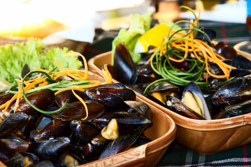 Delicious dish with mussels in the red hot