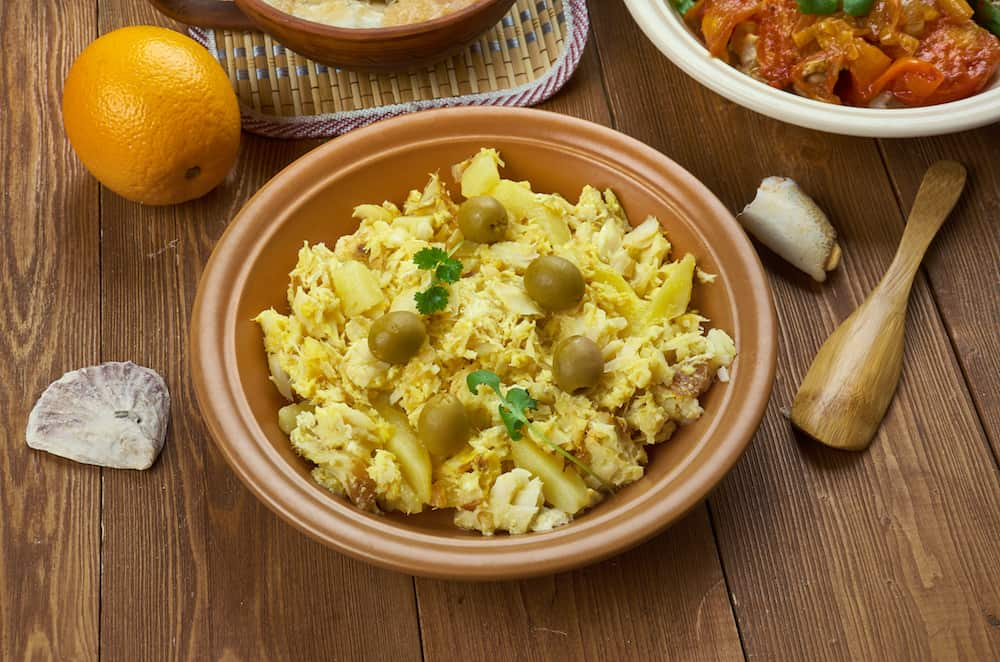 Portuguese cuisine - Bacalhau Bras , Traditional Portugal dishes, made from shreds of salted cod (bacalhau), onions and thinly chopped .