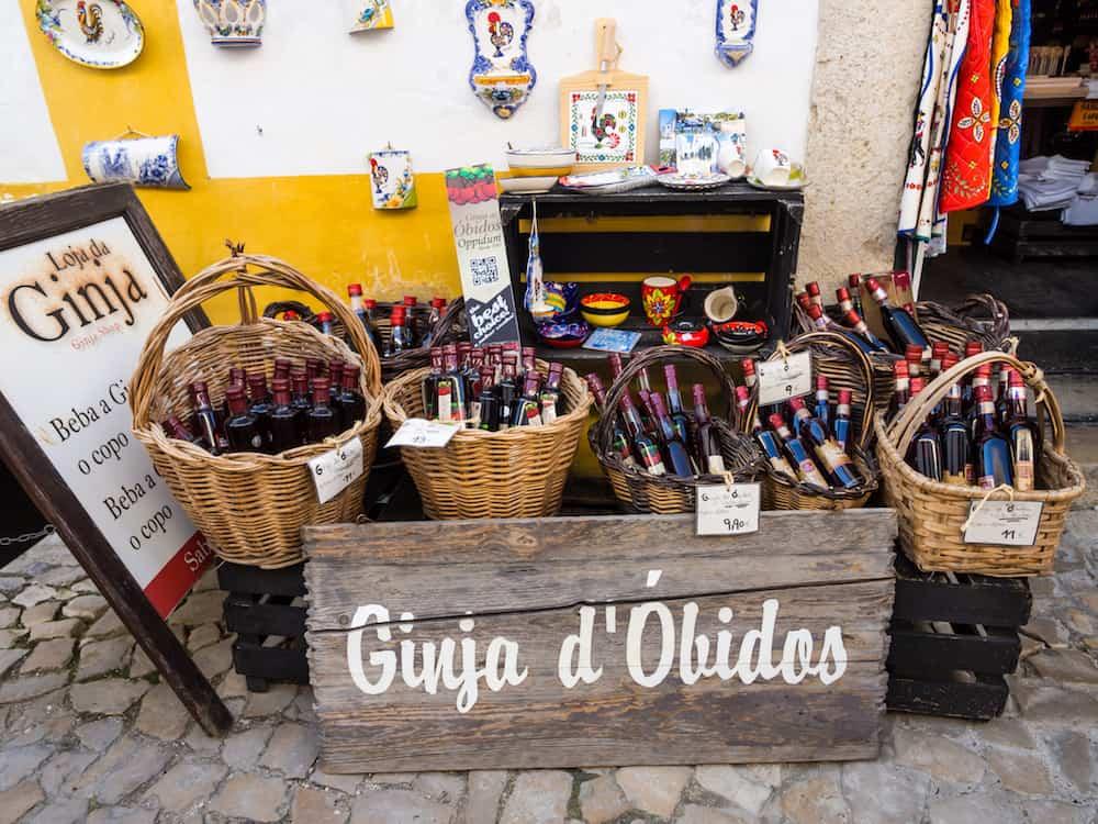 OBIDOS PORTUGAL - Gift store selling Ginja de Obidos traditional regional cherry liquor.