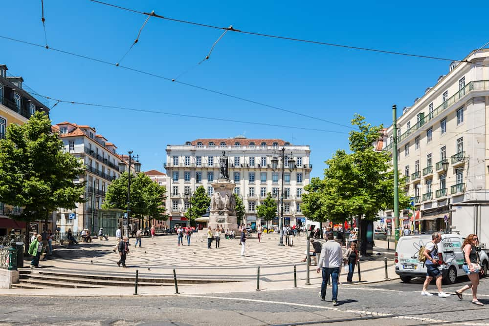 Lisbon, Portugal - People in the square of Luis de Camoes (Praca Luis de Camoes), one of the biggest squares in downtown Lisbon city in Portugal.