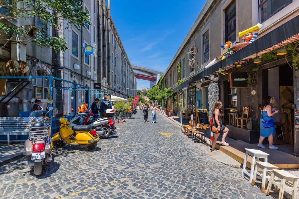 Lisbon Portugal - The very popular Art Centrum LX Factory located under the Ponte 25 de Abril bridge in Lisbon