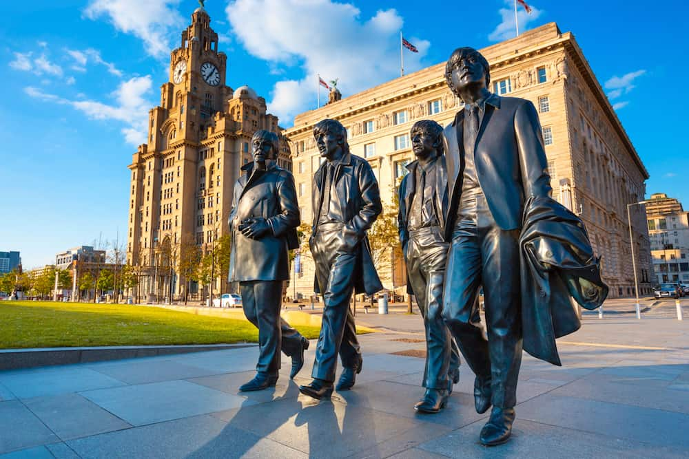 Liverpool, UK - Bronze statue of the Beatles stands at the Pier Head on the side of River Mersey, sculpted by Andrew Edwards and erected in December 2015