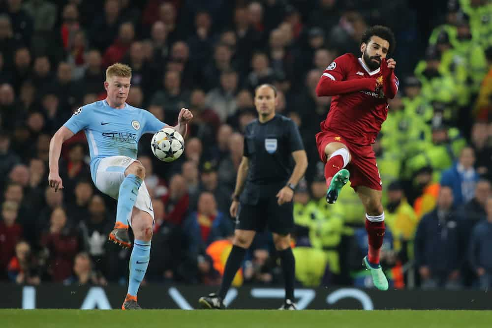 MANCHESTER, ENGLAND : Kevin De Bruyne and Mohamed Salah during the Champions League quarter final match between Manchester City and Liverpool at the Etihad Stadium