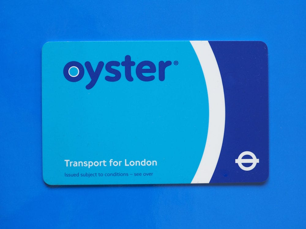LONDON UK - CIRCA The Oyster Card uses near field communication technology for public transport ticketing in and around London over blue background