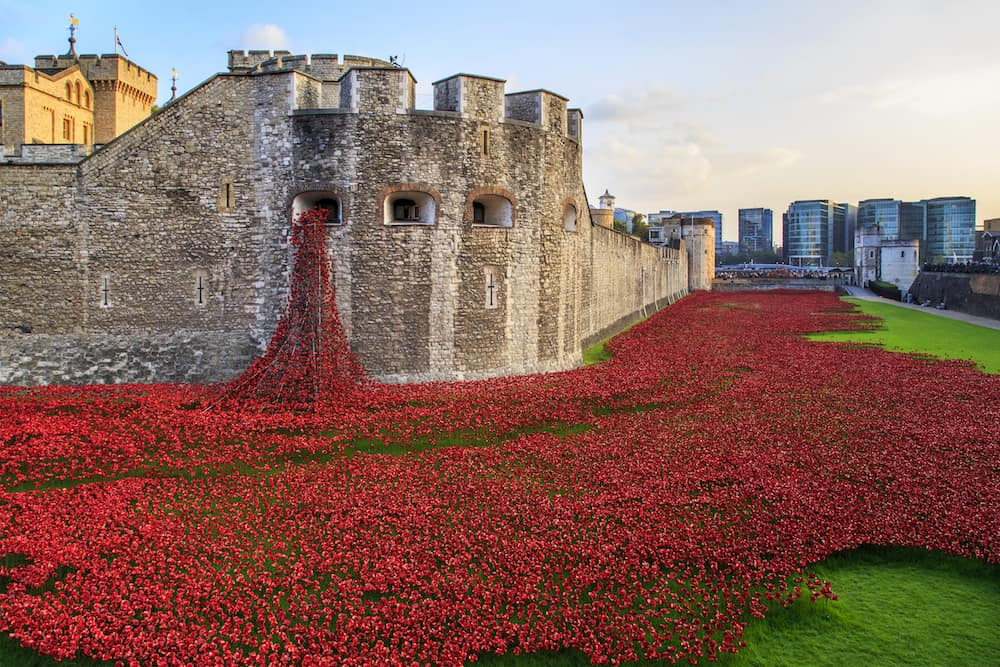 LONDON, GREAT BRITAIN - : This is an installation of ceramic red poppies in memory of those killed in the First World War in the moat of the Tower of London.