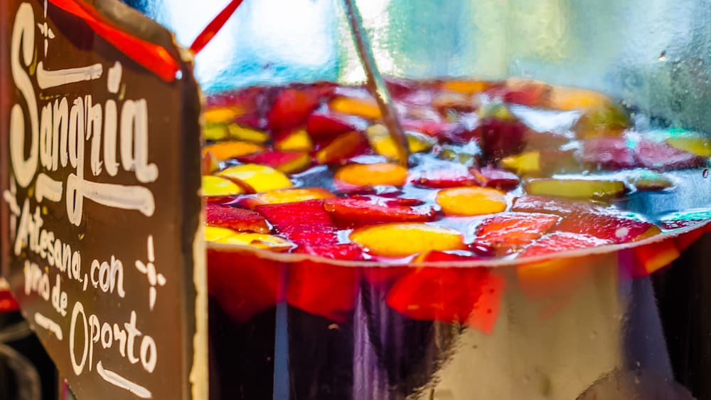 "MADRID, SPAIN - Artisan port wine sangria served at a market stand inside the historical ""Mercado de San Miguel"" (Market of San Miguel), popular among tourists, located in the center of Madrid, Spain"