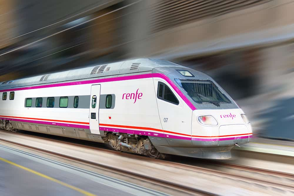 Madrid, Spain Modern hi-speed passenger train of Spanish Railways Company - Renfe, in movement (motion).