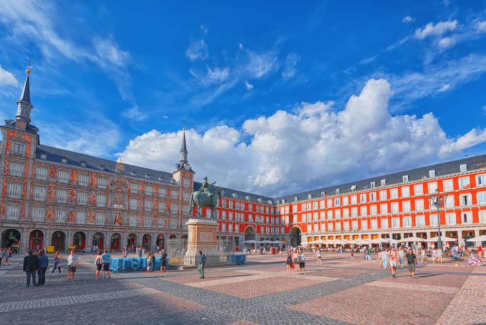 Madrid Spain- : Tourists on Plaza Mayor. Plaza Mayor - one of central squares of the Spanish capital. Located from another famous plaza- Puerta del Sol.