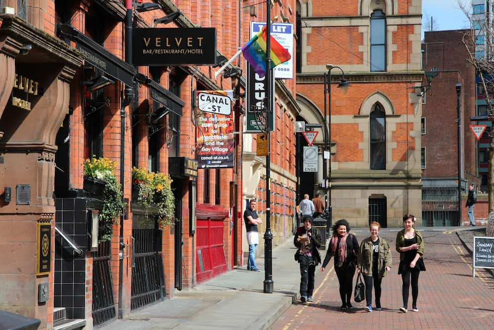 MANCHESTER UK -  People visit famous Gay Village  in Manchester UK. Gay Village is one of oldest and largest LGBT related communities in Europe.